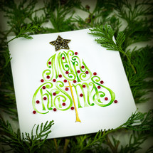 A Christmas card in pine