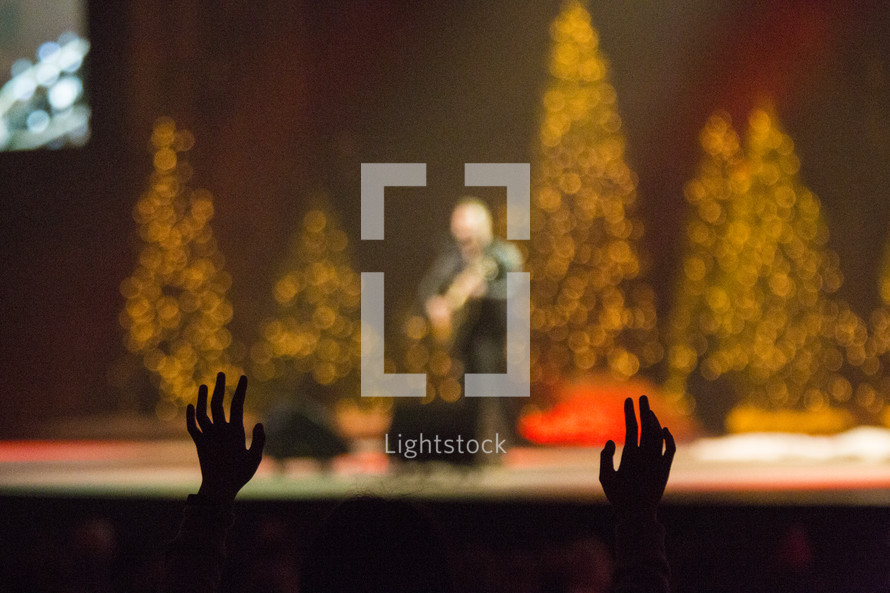 raised hands at a Christmas worship service