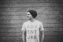 side profile of a man wearing an Adventure t-shirt