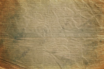 crumpled brown paper textured background.