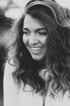 head shot of a teen girl laughing
