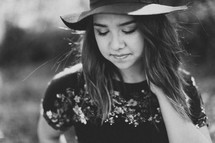 teen girl in a hat with eyes closed