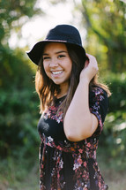 young woman in a hat outdoors