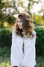 teen girl standing outdoors