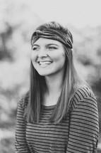 head shot of a teen girl standing outdoors