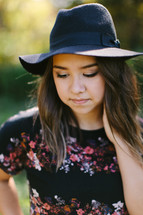 teen girl in a hat outdoors