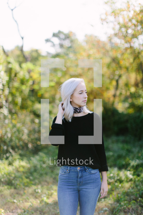 young woman standing outdoors