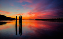 sunset over a calm waters of a lake