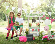 kids selling watermelons