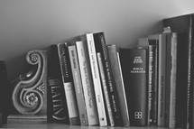 books on a bookshelf at Bible study