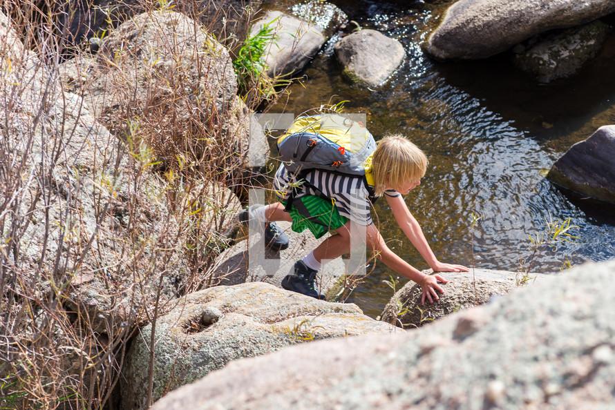 a boy exploring the outdoors