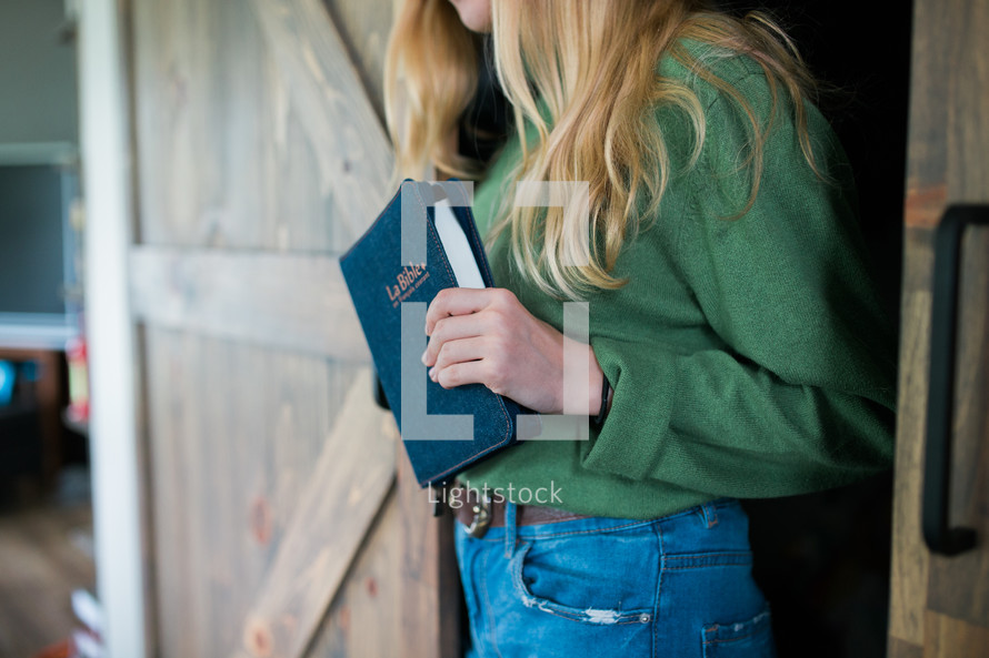 a girl holding a Bible