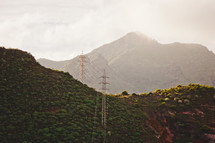 power lines on green mountains in Tenerife, Spain
