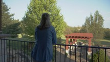 a woman looking over a railing