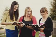 group of women reading from the Bible
