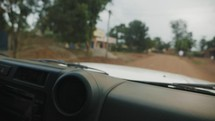 driving through an African village