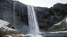 waterfall flowing over a cliff
