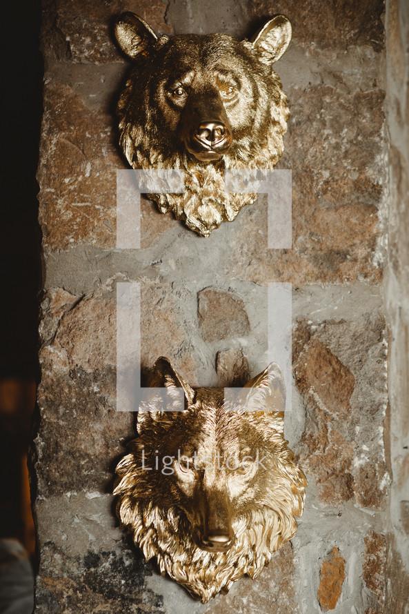 gold wolf and bear head decor
