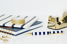 navy and gold items on a desk
