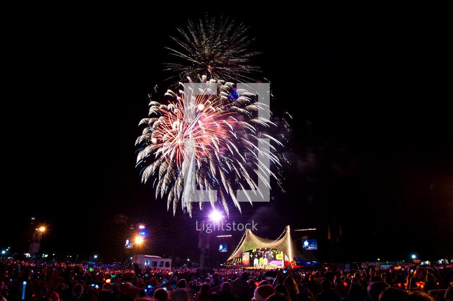 Fireworks over crowd