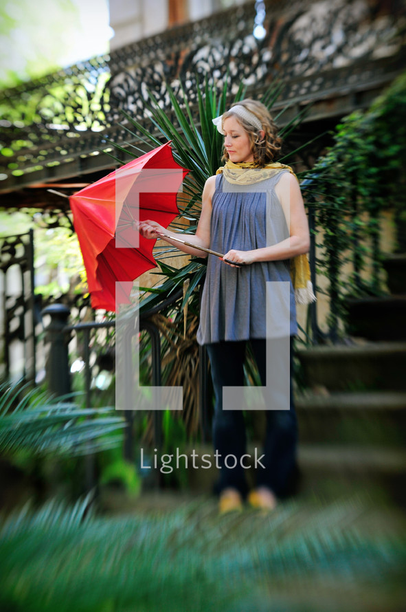 Woman opening umbrella