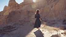 a woman twirling in the badlands