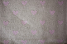 pink hearts on linen fabric