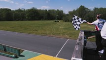Waving the finish flag at race.