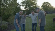 men praying outdoors