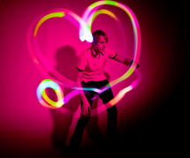 heart shape in lights around a man