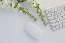 white flowers and computer keyboard