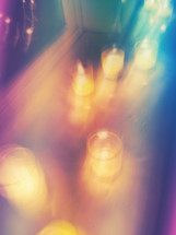 blurry image of votive candles