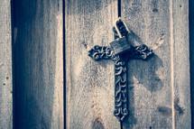 lock and cross on barn doors