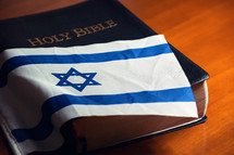 Bible with flag of Israel