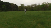 a man running through a field