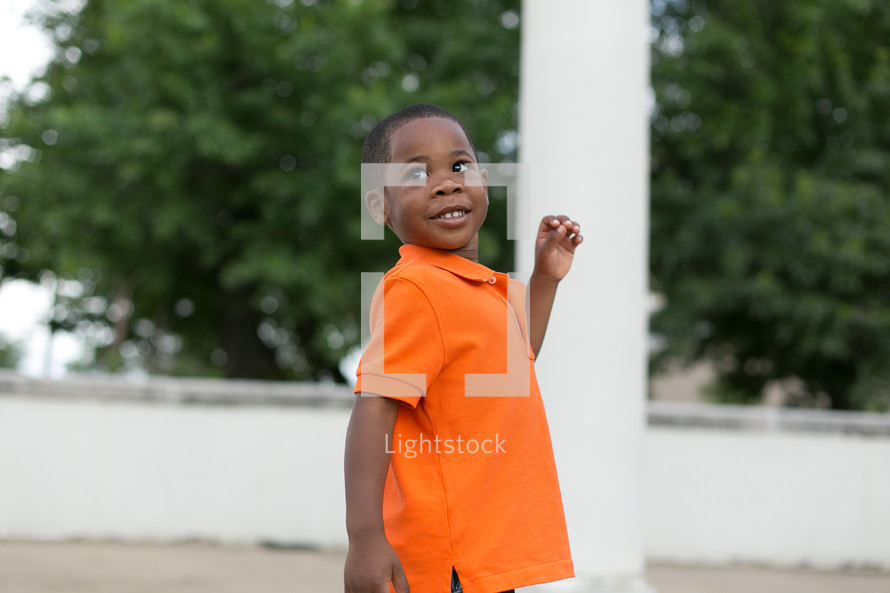 little boy walking outdoors