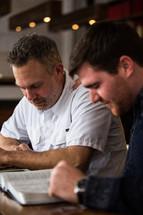 men talking at a Bible study
