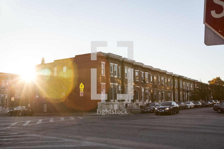 sunburst in front of townhouses