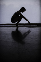 silhouette of a dancer squatting