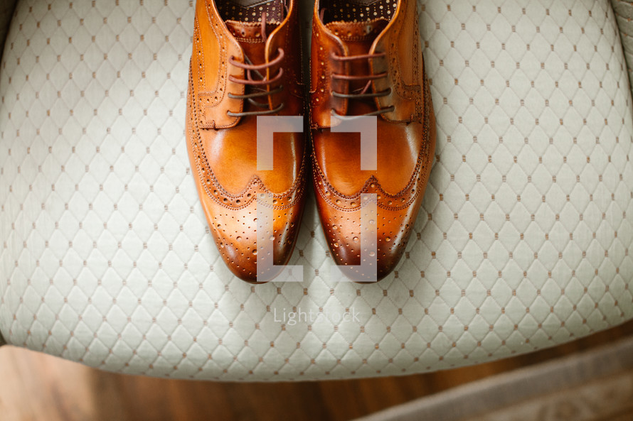 dress shoes on a chair