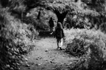 children walking on a trail in fall