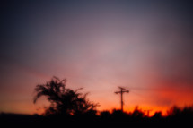 blurry image of power lines at sunset