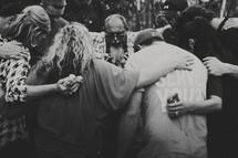 group prayer circle outdoors