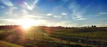 sun shining across the countryside