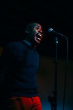 a man at a microphone