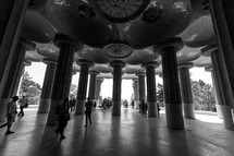 tourists walking between columns