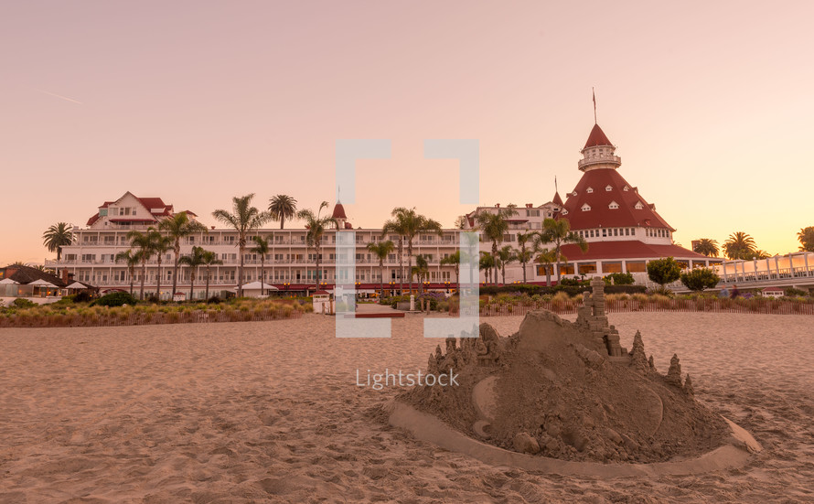 sandcastle on a beach and a resort
