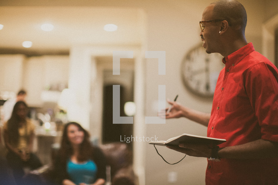 man leading a small group Bible study