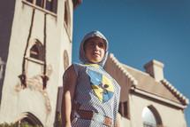 a boy dressed up like a knight