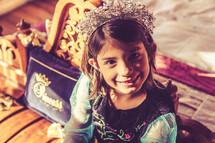 a child dressed up as a princess